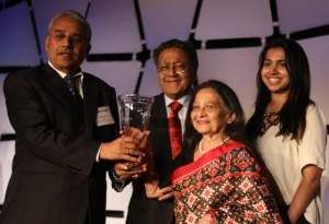 Dr. Markandey Rai (left) presents the Exemplary and Innovative Philanthropy Award to Dr. Manu Chandaria and Mrs. Aruna Chandaria