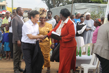 GPF Korea Chairman Kyung Eui Yoo shakes hands after presenting a solar-powered lantern.