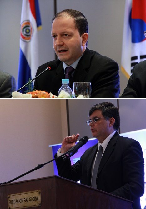 Carlos G. Fernández Valdovinos of the Central Bank of Paraguay (above)and José Molinas Vega, Paraguay's Minister of Planning for Economic and Social Development, emphasize economic data that support a model for growth and development in Paraguay.