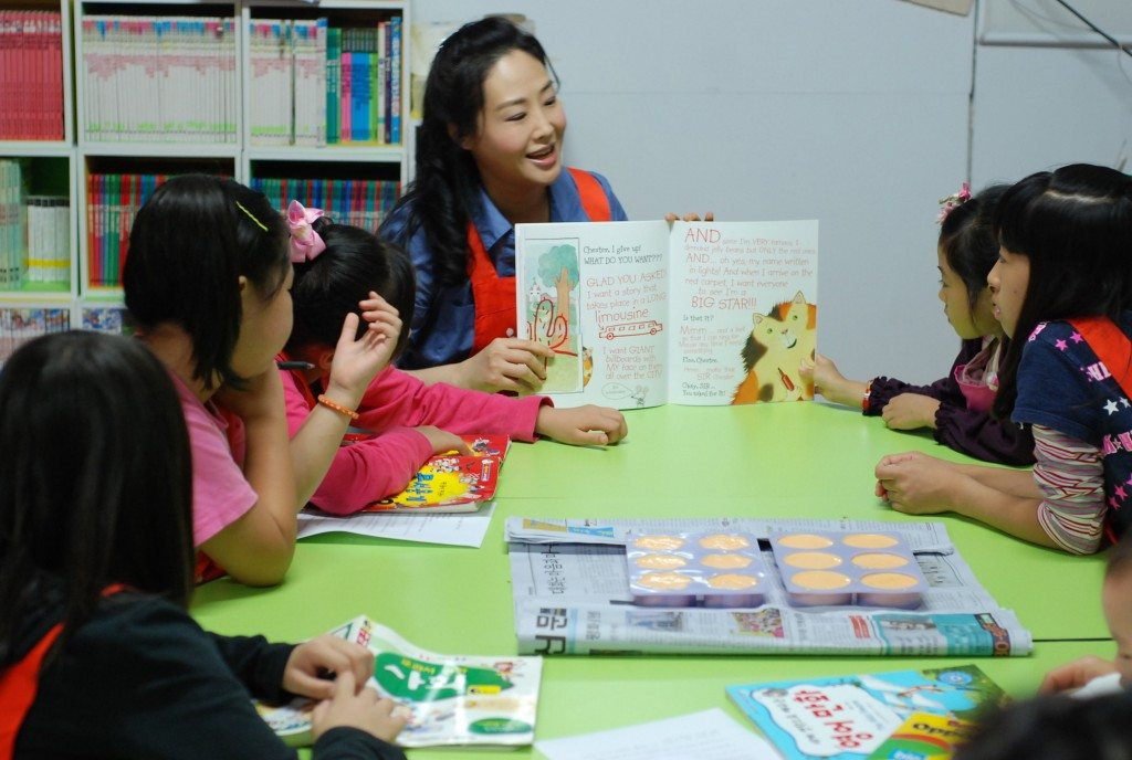 Jun Sook Moon reading to children at at family shelter in Korea.