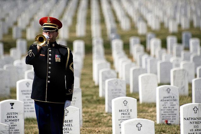 A lone U.S. Army bugler plays Taps at the conclusion of the First Annual Remembrance Ceremony in Dedication to Fallen Military Medical Personnel at Arlington National Cemetery. (DoD photo by Mass Communication Specialist 1st Class Chad J. McNeeley/Released)