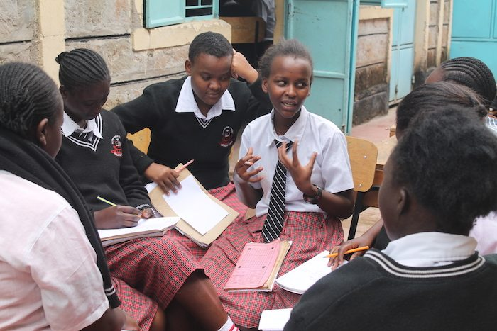 Girls discussing self-confidence and leadership at St. Thaddeus