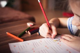 small girl writing