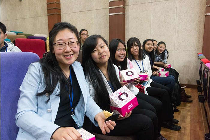 Ohnshim Kim (far left) sits with other youth of the Global Peace Youth Exchange