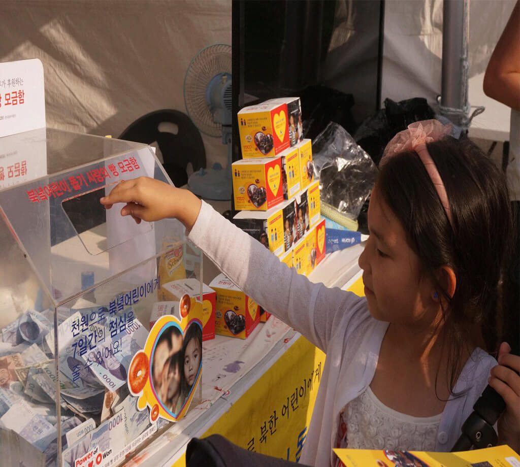 Providing humanitarian aid through projects like 1000 Won, giving bread to children in North Korea.