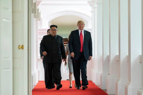 President Donald Trump meets with North Korean leader Kim Jong Un